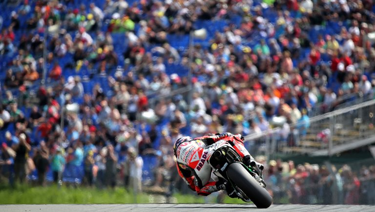 German MotoGP rider Stefan Bradl of the LCR Honda team in action during the free training session held at the Sachsenring race track near Hohenstein-Ernstthal, Germany, 12 July 2013. The German Grand Prix will take place on 14 July 2013. Photo: Jan Woitas/dpa +++(c) dpa - Bildfunk+++